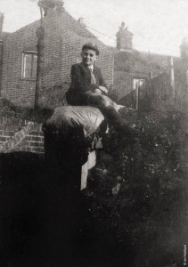Bernard Hubbard, aged 10, sitting on the bomb shelter. A year before the bomb fell.
