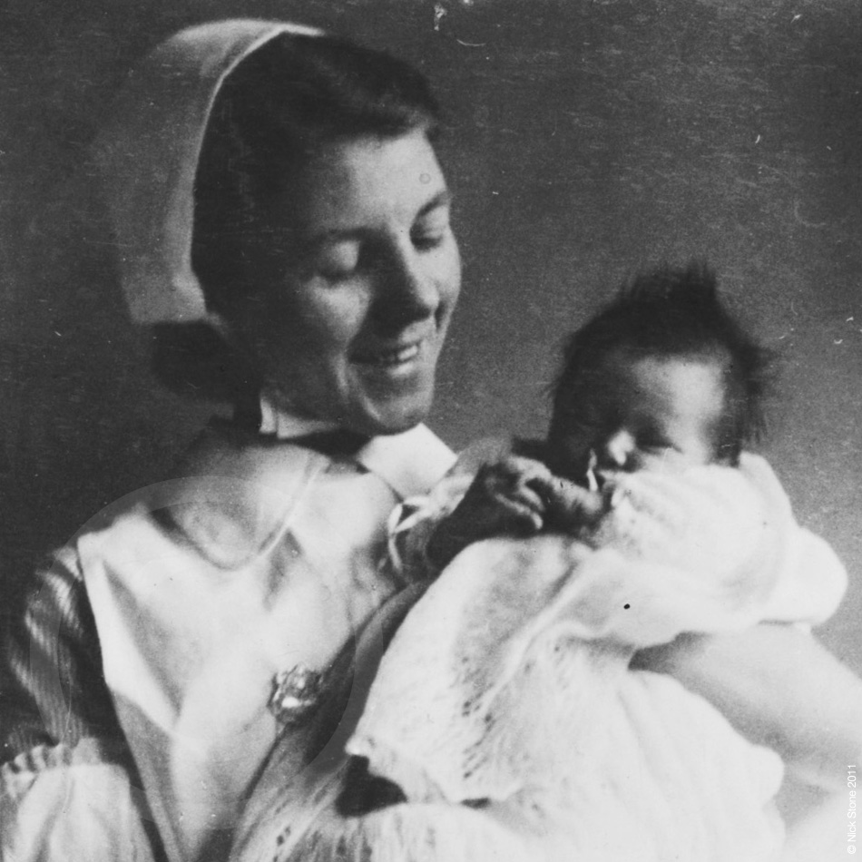 © Nick Stone - Before the NHS, Midwife Grace Stone (Nee Parr) holding baby, London 1930s